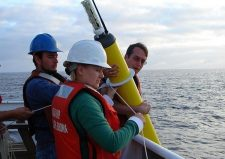 Scientists deploy an Argo probe. (Photo: Elizabeth Crapo, NOAA)