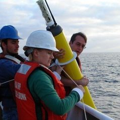 Scientists deploy an Argo probe. (Photo: Elizabeth Crapo, NOAA)