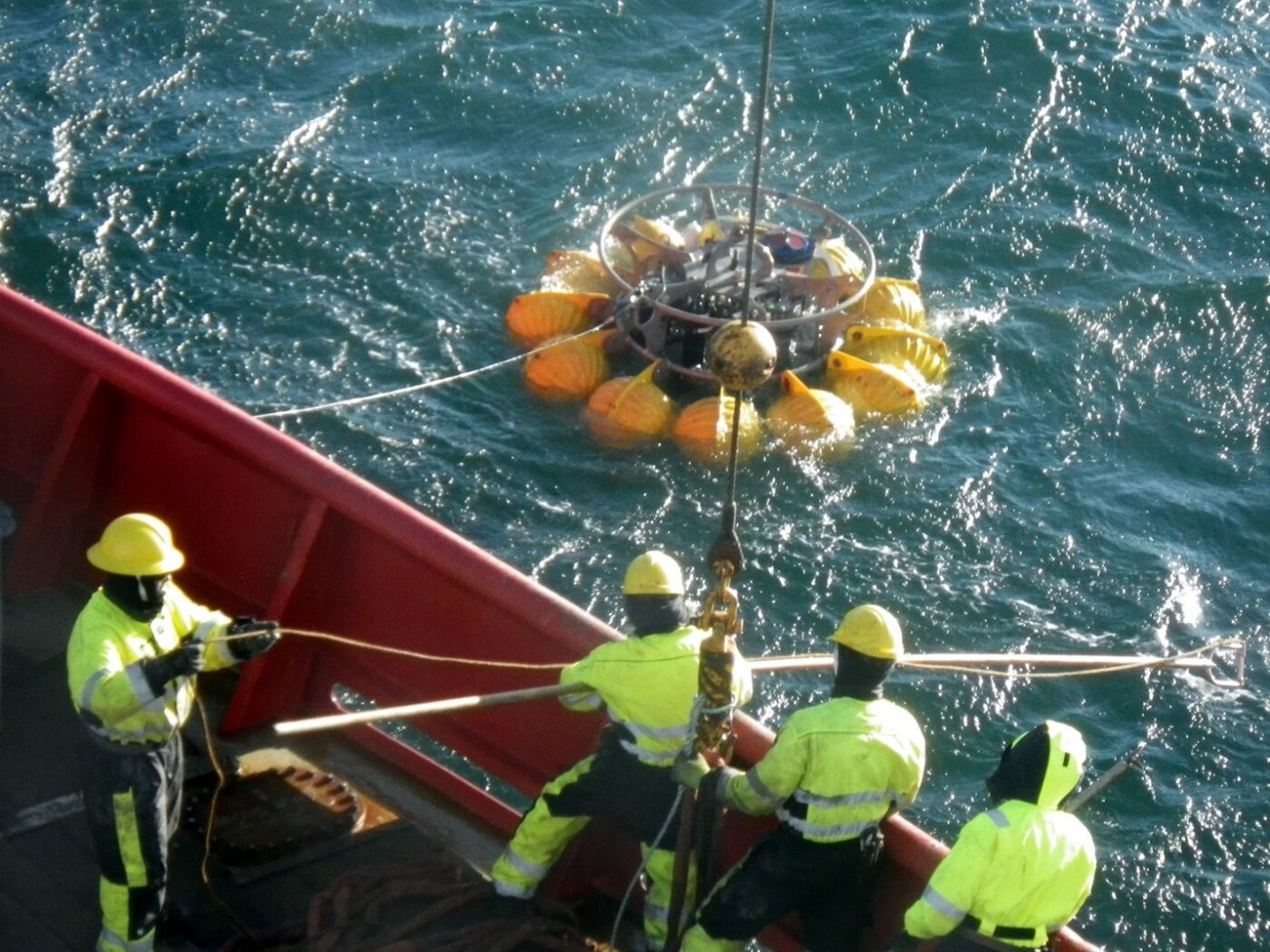 Deploying several sensors and instrumentation in the Beaufort Sea